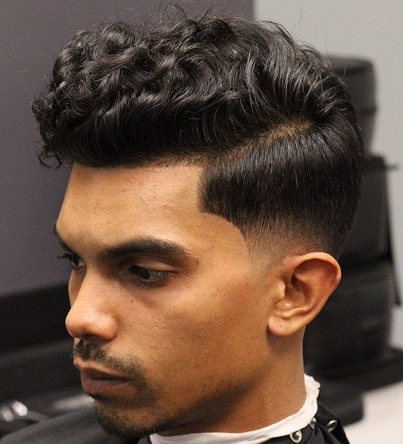 Lockig Top Low Fade Hairstyle