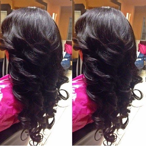dolga V cut and curly hairstyle
