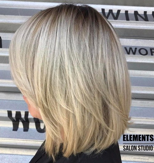 Blond Layered Bob With Stretched Roots